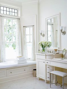 Beautiful and feminine bath with custom millwork! Love the window and transom! via bhg.com