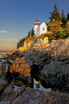 "The Harris Head Light - sits on the next headland over from The Heights, marking the leftmost edge of the Harbor.  --Conceptualizing ""The Selkie Woman""  (Acadia Natl. Park and lighthouse, Maine, USA)"
