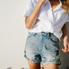 A go to look this summer: A pair of denim jeans and a white looks shirt tucked in.