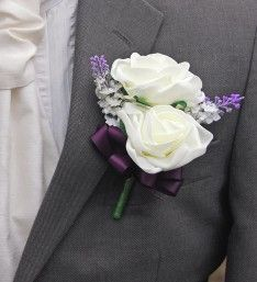 A grooms wedding day double buttonhole with two ivory Beth foam roses, silk ivory lavender spray, finished with a handmade purple coloured satin ribbon bow Rose Wedding, Wedding Groom, Wedding Day, Lilac, Lavender, Purple, Button Holes Wedding, Foam Roses, Ivory Silk