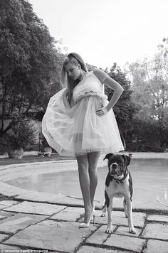 Dancin': The 23-year-old played with the fabric of her ballerina-inspired skirt as she stood poolside in her stilettos