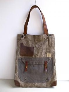 1960s era Canvas Tote Bag by Ranposki 1960s era Swedish military canvas has been reworked into a perfect everyday holdall tote bag with leather strap, pocket and bottom corner. Bag measures approximately 14.5 in (38cm) wide, 18.5 in (47cm) tall, 6 in (15cm) deep Strap drop approximately 10.5 in (27cm) #Totes #handbagsdiyupcycle