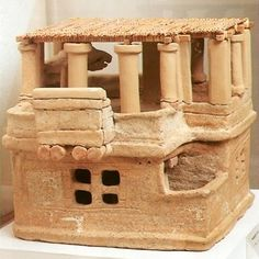 Archanes: The so-called Archive in the palace building yielded this terracotta figurine of a house with five storeys, a peristyle flat roof, and a balcony. The model contains accurate architectural details: doors, windows, columns, etc., and the masonry and timber framework is rendered by incision. Flat roofs were made of perishable materials (timber, reeds, grass).