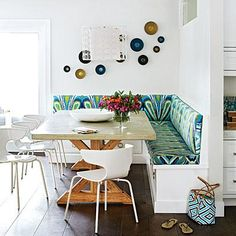 This fun breakfast nook is steeped in cool California style. Ikat-inspired Trina Turk fabric adorns the banquette and simple white dining chairs round out the seating. Coastalliving.com