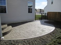 A great set of curved stairs complete the look of this rounded patio by Precision. : curved patio - thejasonspencertrust.org