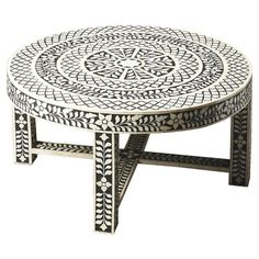 Cocktail table with a mosaic-inspired bone inlay design.  Product: Cocktail tableConstruction Material: Select w...