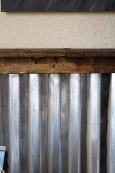 corrugated metal and wood instead of board and batten for boys' bed/bathroom.  super fun!