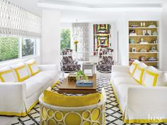 Designer Josh Wollowick and assistant designer Elizabeth Driebholz, used a fresh palette—lots of crisp white with soft grays and dashes of aqua and citrusy hues. In the living room, a cheery yellow accents the white sofas and side chair.