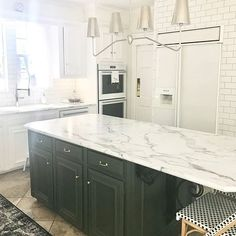 A stunning kitchen remodel featuring 3460 Calacatta Marble by Formica Group via Refinish Countertops, Marble Countertops, Kitchen Countertops, Calacatta Marble, Kitchen Cabinets, Cheap Kitchen Remodel, Kitchen Reno, Green Kitchen Island, New Kitchen Designs