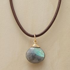 """INKLING NECKLACE--Labradorite is said to inspire insight. Hung upon a leather cord and reflecting ever-shifting shades of green and gray. 14kt goldfilled with brass endcaps. USA. Exclusive. 16 to 17-1/2""""L."""
