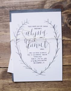 Handrawn wedding invitations - simple, elegant, delicate, clean on white paper & hand lettered with laurel wreath