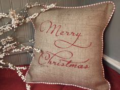 Merry Christmas hand painted in red on natural  burlap pillow cover with red and white french ticking, piping. $35.00, via Etsy.