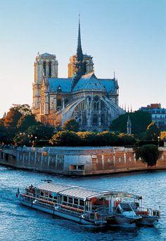 Bateaux Parisiens River Cruise, Port de la Bourdonnais, 75007, Paris. The Notre Dame Cathedral is in the background.
