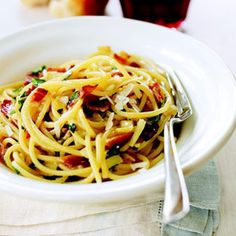 Spaghetti Carbonara:From Good Housekeeping & triple-tested at the Good Housekeeping Research Institute - Beaten eggs and plenty of Romano cheese form a lightly creamy sauce in this bacon-studded Italian pasta dish.