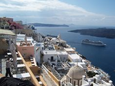 Eastern Mediterranean - A cruise ship sails away from Santorini, Greece.   credits: Vanny