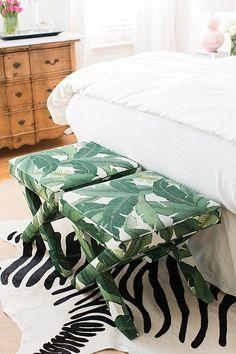 brighton keller bedroom palm leaf print x bench at foot of bed over zebra hide rug