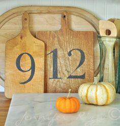 vintage cutting boards with numbers added, such a cute idea!