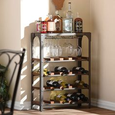 Evoking rustic industrial style with its weathered and timeworn patina, this Dunedin Rustic Industrial Style Antique Bronze Finishing Metal Vintage Walnut Wood Wine Storage Rack shows off your refined taste while maintaining an open look in your room.