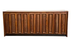 A rare and possibly one-of-a-kind walnut credenza by Dillingham featuring pecky cypress moldings. Pecky Cypress is the result of a fungus living on old cypress trees. Once the tree is harvested, the fungus dies. The fungus creates narrow burrows in the wood, which create a unique and beautiful pecky patterns. Pecky Cypress is difficult to find and highly sought after; it is rarely seen in Mid-Century Modern furniture.   This buffet features two pairs of doors flanking a center cabinet. Each…