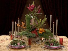 Use winterberry stems to make spectacular centerpieces and other arrangements. A red lily tops this tablescape of winterberries, Oriental lilies, calla lilies, greenery and rose hips.