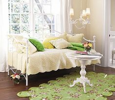 Love the creme and white with the green pops of color...