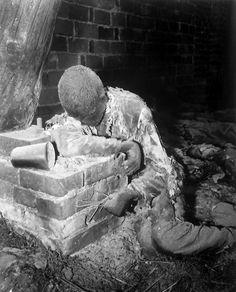 One of 150 prisoners savagely burned to death by Nazi SS troops as Allied troops closed in on the camp still rests in the position in which he died, attempting to rise and escape his horrible death, Gardelegen, 16 Apr 1945 - Sgt. E. R. Allen