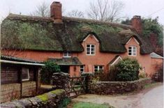 Here's yet another old English cob cottage--with a beautiful red earthy color
