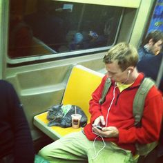 Yup, nothing to see here.  Just a cat wearing a paisley sweater on the subway drinking a milkshake.
