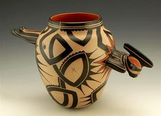 While relying on the tourism market for income, many contemporary New Mexican artists use their work as a way of reaffirming old cultural values. Black, polished and carved pottery by Indians at Santa Clara Pueblo is still done by families, but also as individuals as a means of individual self expression.