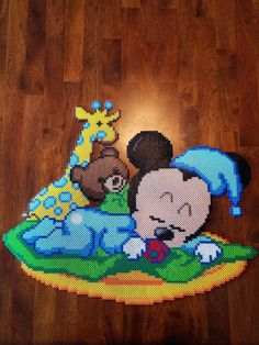 18 inch high by 22 inch wide sleeping baby Mickey made from perler beads Perler Bead Designs, Hama Beads Design, Pearler Bead Patterns, Perler Patterns, Pearler Beads, Perler Bead Disney, Perler Bead Art, Baby Mickey, Cross Stitch Silhouette