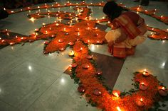 A Hindu woman lights candles used in a temple in Dhaka, Bangladesh