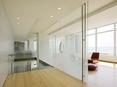 Sandblasted glass walls and sliding doors allow light deep into Krueck + Sexton's Cloud Residence in Milwaukee Sandblasted Glass, Dental Office Design, Creativity And Innovation, Sliding Doors, Living Spaces, House Design, Architecture, Glass Walls, Bath Ideas