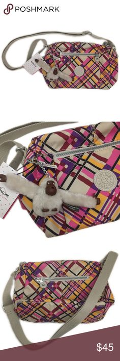 """⬇PRICE DROP⬇Kipling Crossbody w/Furry Monkey Charm 100% authentic, Material: printed polyester, Print Design: cream plaid, adjustable crossbody strap which measures approximately 52.5"""" in full length, zip compartments on both sides, top zip closure, zip compartment inside and a smaller compartment to stash phone, cash or cards. Measures approximately 10.5"""" in width, 8"""" in length. Kipling Bags Crossbody Bags"""