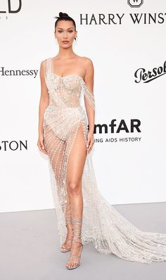 Every celebrity is trying out the see-through dress trend. Discover all the best looks, and shop our edit of the best here.