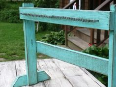 Need to make this. Maybe in an antique finish in white with turquoise peeking through. I would love to use horse shoeing nails for a really rustic look