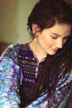 This is incredibly similar to what my dreads looked like... As elegant as dreads could ever be. I miss them, I think I shall recreate them this month...