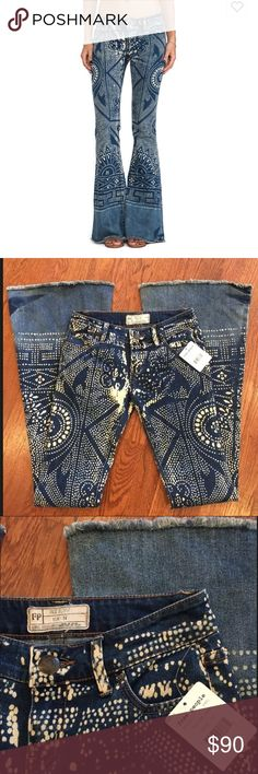 """Free People Bali Malaya Raw Hem Boho Flare Jeans Sold out, hard-to-find Free People 'Bali' jeans in a size 24! Brand new with tags, no issues to note.  Sun-bleached denim in a Dutch-wax motif and raw-edge hems complete a pair of retro flare-leg jeans styled with plenty of castaway cool. 'Malaya' wash. • Approx. inseam: 34"""" with 12"""" leg opening • Approx. rise: front 7.5""""; back 9.5"""" • Hip (taken flat): 16"""" • Zip fly with button closure • Five-pocket style • 71% Cotton/28% polyester/1% spandex…"""