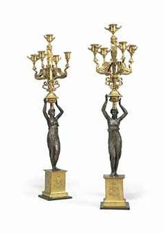 A PAIR OF NORTH-EUROPEAN ORMOLU AND PATINATED BRONZE FIVE-LIGHT CANDELABRA  EARLY 19TH CENTURY; ADAPTED.