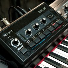 Roland VP-7 Vocoder.  Tunes what you say into a mic to what you play on the keys.  Can do like a talk-box effect with a synth sound or give yourself backing harmonies with choir or pads on your keyboard. I would see live performances and find the backup vocals kind of lacking.  You could just use this and it'd sound like you have a whole backing section.  C'mon Dragonforce! Make it happen!