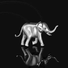 Unique solid sterling silver elephant necklace pendant, in matte finishing with glossy details to highlight the design. A micro-sculpture in a jewel! This jewelry have a wonderful detailing and flawless 3D craftsmanship with my unique repousse technique. #elephant #elephantjewelry #elephantnecklace #elephantpendant #elephantgift #elephantlove #elephantjewellery #elephantcharm #elephantlover #elephantlovergift