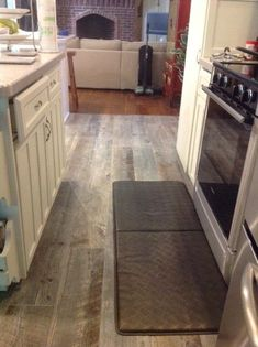 Lowe's Natural Timber - Ash - Porcelain tile that looks like wood for the kitchen