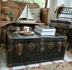 by kaitlin Travel trunk coffee table. by kaitlin Travel trunk coffee tabl Rustic Trunk Coffee Table, Trunk Table, Diy Coffee Table, Decorating Coffee Tables, Old Trunks, Vintage Trunks, Trunks And Chests, Antique Trunks, Vintage Steamer Trunk