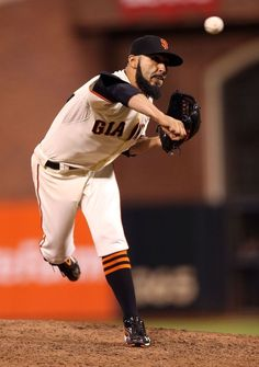SAN FRANCISCO, CA - OCTOBER 25:  Sergio Romo #54 of the San Francisco Giants throws a pitch against the Detroit Tigers during Game Two of the Major League Baseball World Series at AT Park on October 25, 2012 in San Francisco, California.