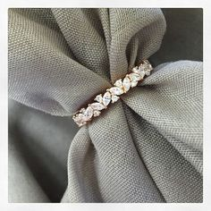 Custom beauty! We love this custom diamond eternity ring, which is made from 18 karat rose gold. The ring resembles a garland and is fashioned from marquise cut and round brilliant cut diamonds. Email general@debebians.com for pricing and inquiries.