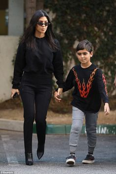 Doting mom: On Wednesday, Kourtney Kardashian was seen out with her seven-year-old son Mason near their home in Calabasas, California