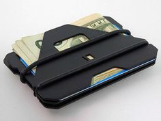 The Obstructures A3 Aluminum Plate Wallet is a super compact wallet just large enough for typical credit cards and cash with a unique opening feature.