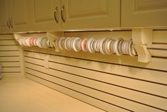 Ribbon storage; steel rods inserted into corbels with routered slots