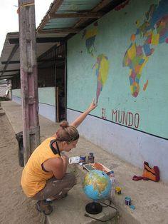 A volunteer working on a school mural in Esmeraldas, Ecuador. #ubelong #volunteerabroad