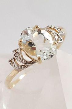 Online veilinghuis Catawiki: Gouden ring met een natuurlijke aquamarijn en 4 briljant geslepen diamanten