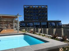 Custom made engineered acid -itched jura copings for pool at Silo 3 V&A Waterfront.